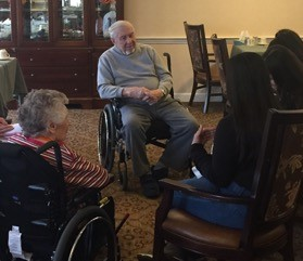 Photo of a student interacting with the senior living residence