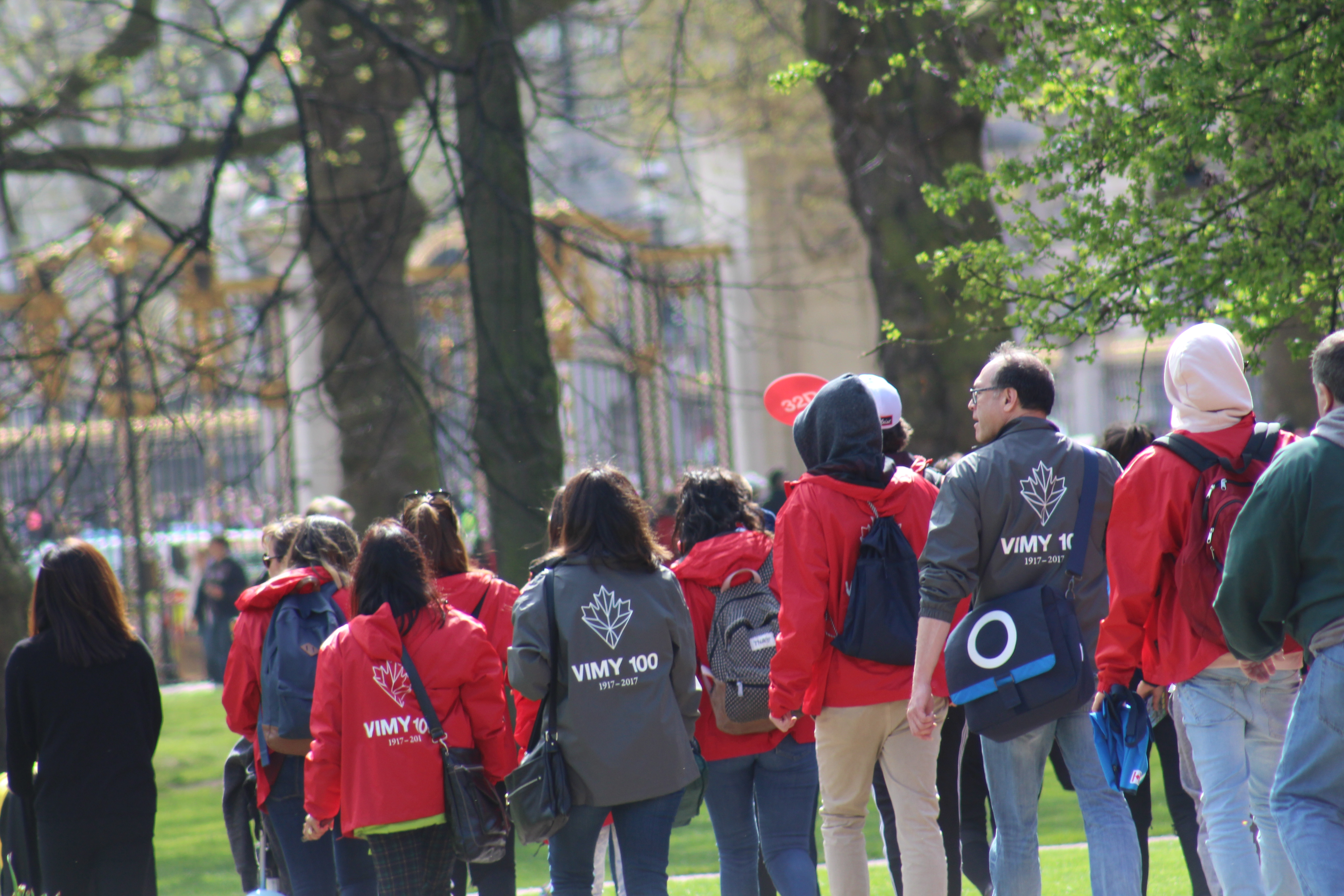 Tour groups in Red and Grey Vimy Ridge Jackets walking