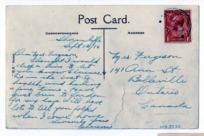 Backside of the postcard with a handwritten letter.