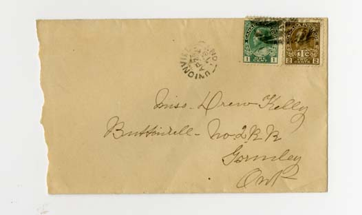 Envelope with two stamps and address.